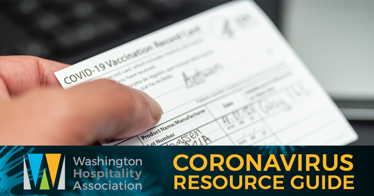 person holding official COVID-19 CDC vaccination card